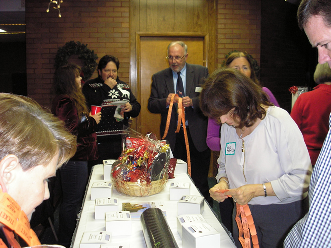 Raffle Selling at 2014 Holiday Party